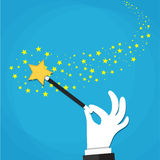 Cartoon Hand hold magic wand with stars sparks. Stock Images