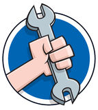 Cartoon hand holding a wrench Royalty Free Stock Photo