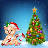 Cartoon happy bear with Christmas tree on a night sky background stock illustration