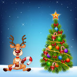 Cartoon happy deer with Christmas tree on a night sky background Royalty Free Stock Photography