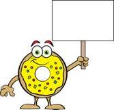 Cartoon happy donut holding a sign. Stock Photos