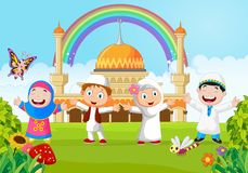 Cartoon happy kid muslim with rainbow Royalty Free Stock Images