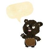 cartoon happy little teddy black bear with speech bubble Stock Image