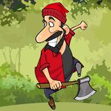 Cartoon happy lumberjack runs through the forest with an ax Royalty Free Stock Photography