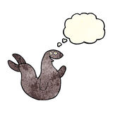 Cartoon happy seal with thought bubble Stock Image