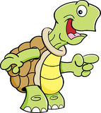 Cartoon happy turtle pointing. Royalty Free Stock Photos
