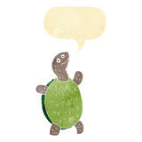 Cartoon happy turtle with speech bubble Royalty Free Stock Photography