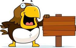 Cartoon Hawk Sign. A cartoon hawk standing next to a wood sign Royalty Free Stock Image