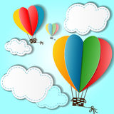 Cartoon heart shaped balloons and clouds in the sky Stock Images