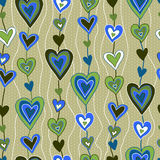 Cartoon hearts seamless pattern. Hand drawn cartoon hearts seamless pattern in light green and blue. Endless background Stock Photography