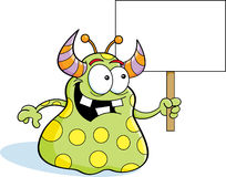 Cartoon alien holding a sign Royalty Free Stock Photo