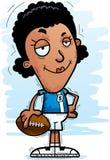 Confident Cartoon Black Football Player. A cartoon illustration of a black woman football player looking confident stock illustration