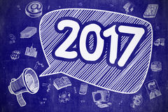 2017 - Cartoon Illustration on Blue Chalkboard. 2017 on Speech Bubble. Cartoon Illustration of Shouting Mouthpiece. Advertising Concept. Speech Bubble with Stock Photo