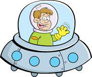 Cartoon boy in a spacecraft. Cartoon illustration of a boy flying in a spacecraft Royalty Free Stock Photography