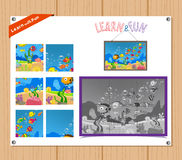 Cartoon Illustration of Education Jigsaw Puzzle Game for Preschool Children with sea life Stock Image