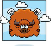 Cartoon Yak in the Sky. A cartoon illustration of a yak flying in the sky Royalty Free Stock Images