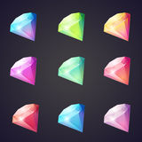 Cartoon image of gems and diamonds of different colors on a black background for computer games. Stock Images