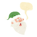 Cartoon jolly santa claus face with speech bubble Stock Photo