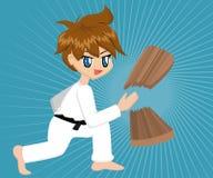 Cartoon Karate Boy. Cute cartoon karate boy with black belt chopping a wooden plank Royalty Free Stock Photo