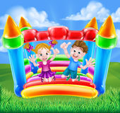 Cartoon Kids on Bouncy Castle Stock Images