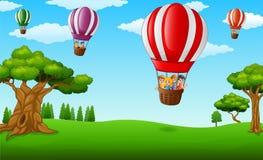 Cartoon kids inside a hot air balloon flying over a green park Stock Images