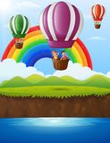Cartoon kids inside a hot air balloon flying over a river Royalty Free Stock Image