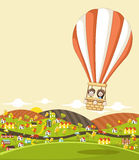 Cartoon kids inside a hot air balloon Royalty Free Stock Photography