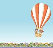 Cartoon kids inside a hot air balloon Stock Images