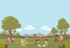 Cartoon kids playing. Green grass landscape with cute cartoon kids playing. Sports and recreation Royalty Free Stock Image