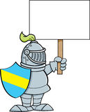 Cartoon knight holding a sign. Royalty Free Stock Photography