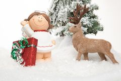 Cartoon Lady holds a christmas present Royalty Free Stock Images
