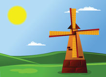 Cartoon landscape. Cartoon scenery with sun, mill and green field Stock Photo