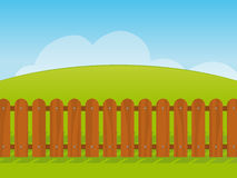 Cartoon landscape with a wooden fence. Clean fresh cartoon landscape with a green grass hill under a blue sky with a wooden picket fence in the foreground Stock Photography