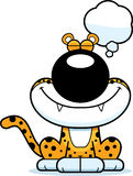 Cartoon Leopard Dreaming. A cartoon illustration of a leopard dreaming Stock Images