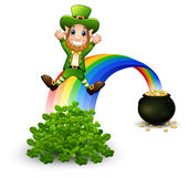 Cartoon leprechaun sliding down the rainbow Stock Image