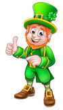 Cartoon Leprechaun St Patricks Day Character. Giving a thumbs up and pointing royalty free illustration