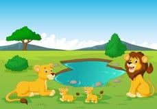 Cartoon lion family near watering hole Royalty Free Stock Photo