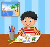 Cartoon little boy drawing Stock Photography