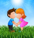Cartoon little boy and girl kissing in the grass on a background of bright sunshine. Illustration of Cartoon little boy and girl kissing in the grass on a Stock Photo