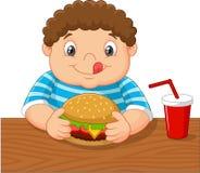 Cartoon little boy holding hamburger Stock Photo