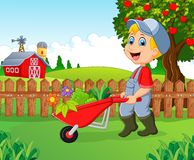 Cartoon little boy holding wheelbarrow. Illustration of Cartoon little boy holding wheelbarrow Royalty Free Stock Images