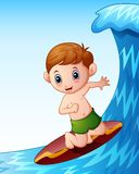 Cartoon little boy playing surfboard on the sea Stock Images
