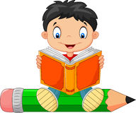 Cartoon little boy reading a book Stock Image