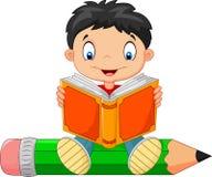 Cartoon little boy reading a book Stock Image