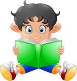 Cartoon little boy reading a book Stock Photos
