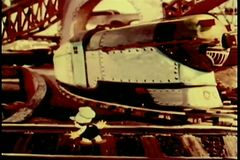 Cartoon of little boy running through train yard stock video footage