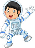 Cartoon little boy wearing astronaut costume Royalty Free Stock Image