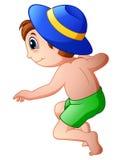 Cartoon little boy wearing a hat jumping Royalty Free Stock Photo