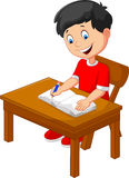 Cartoon little boy writing Royalty Free Stock Image