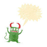 Cartoon little devil with speech bubble Stock Photo